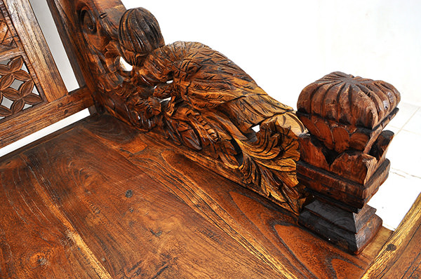 Indonesian ethnic day bench with wood carvings