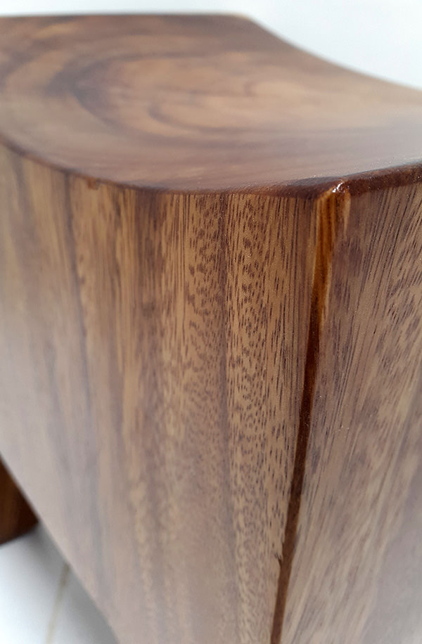 curved wooden stool with semi gloss finish