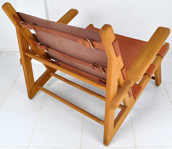 natural teak and brown leather lounge chair