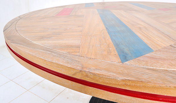 teak dining table with red and blue solid paint