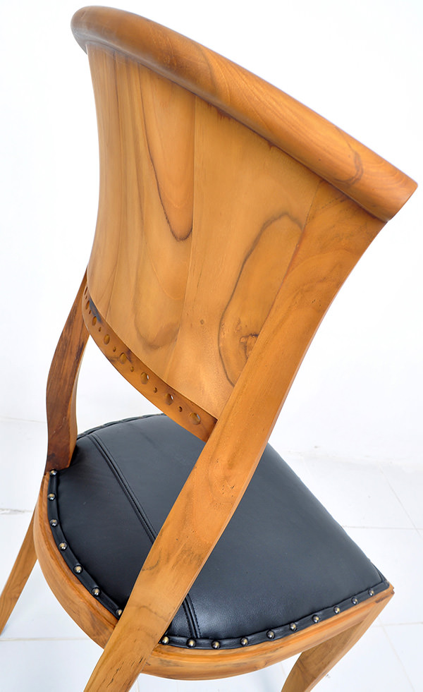 natural teak stain and black leather chair