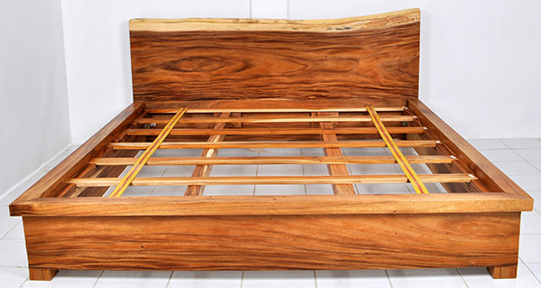 raw wooden bed