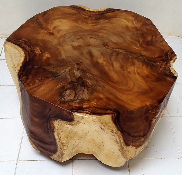 solid wooden table with natural shapes