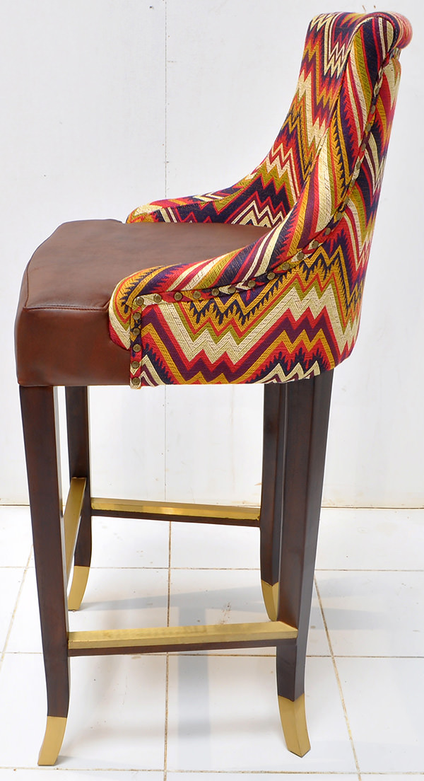 Peruvian restaurant bar seat with pattern fabric and brown leather