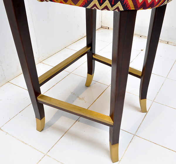 Peruvian restaurant bar seat with brass fittings