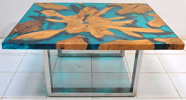 solid teak root and resin coffee table with stainless steel legs