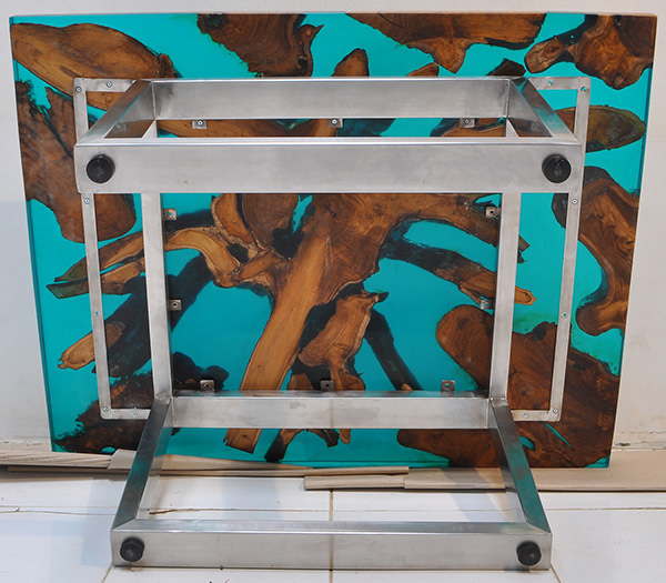 teak root and blue resin coffee table with stainless steel legs
