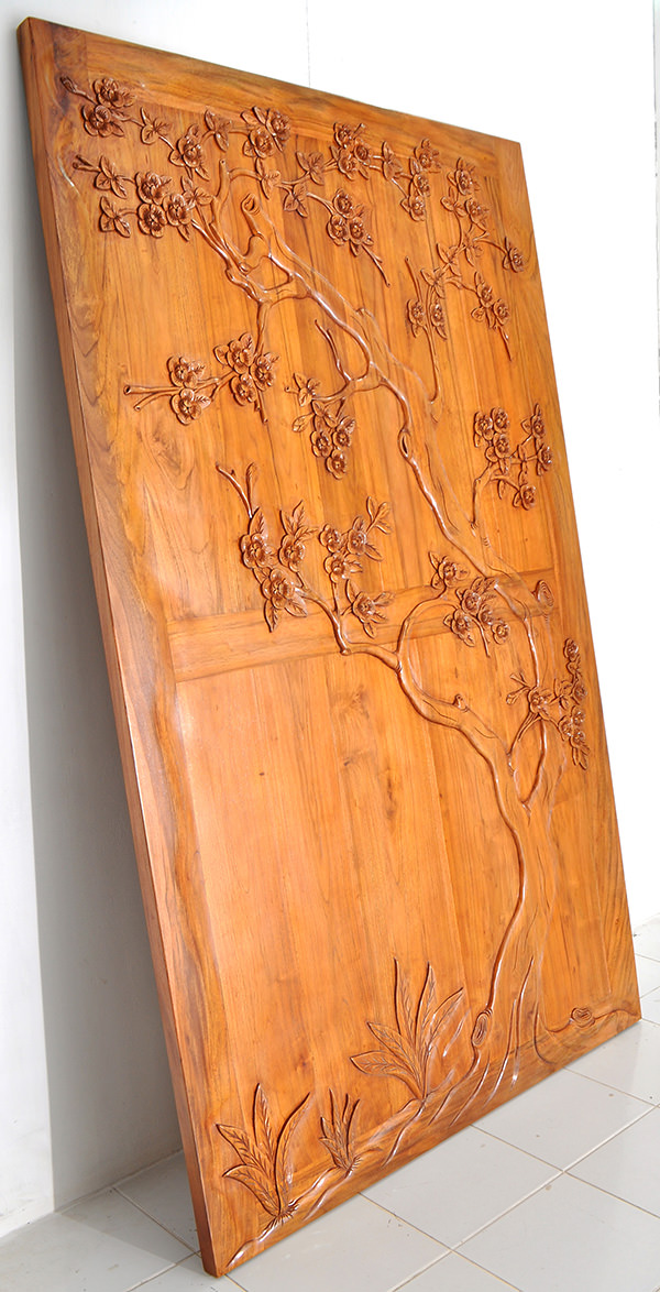 Hand-carved wooden panel