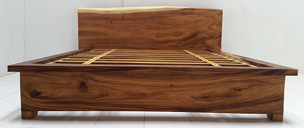 suar bed frame with headboard with a natural shape