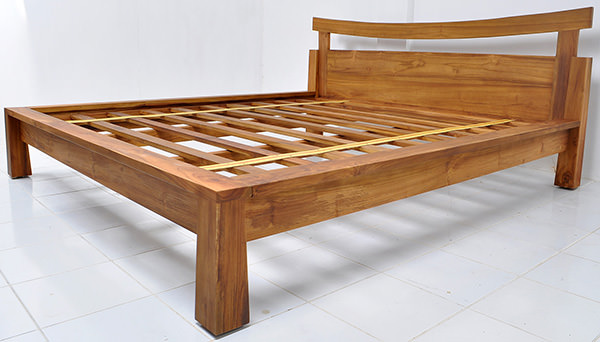 simple teak bed frame with natural stain and matte coatin
