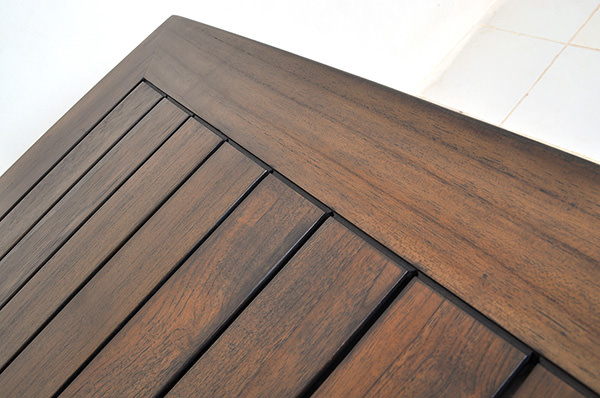 teak table top with open wood lamination