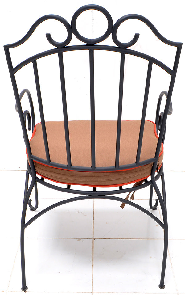 outdoor black iron armchair and linen cushion