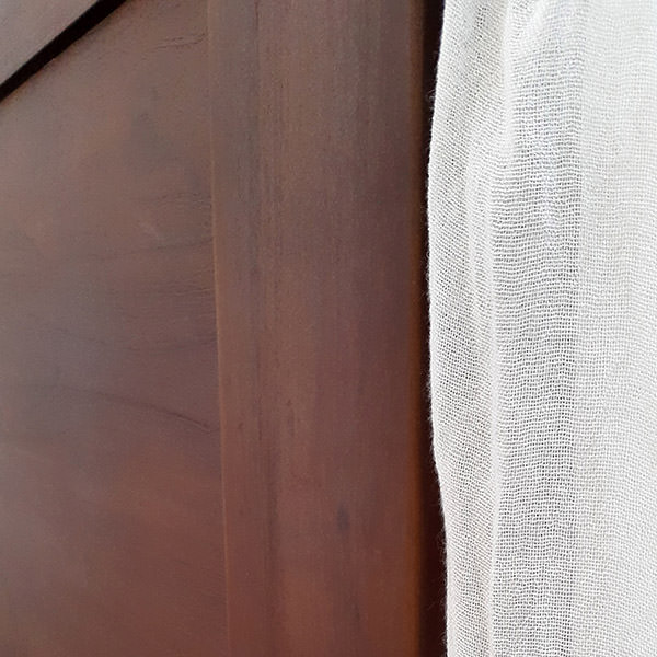 dark brown teak canopy bed