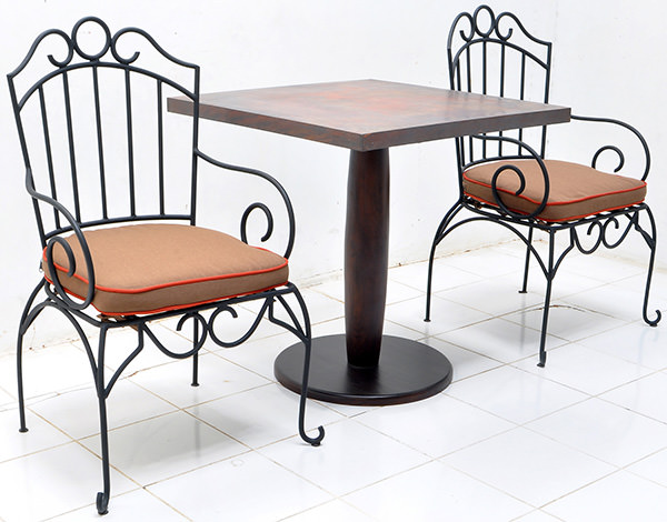 outdoor iron chair and copper table