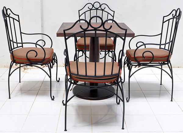 set of hospitality four outdoor iron chair and one copper table