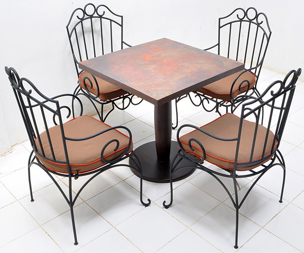 set of hospitality four outdoor iron chair and one square copper table