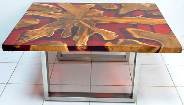 solid teak root and red resin coffee table with square glossy stainless steel legs