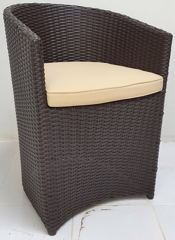 black synthetic rattan armchair with white pillow