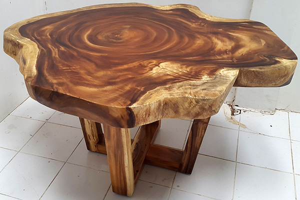 suar coffee table with crossed legs