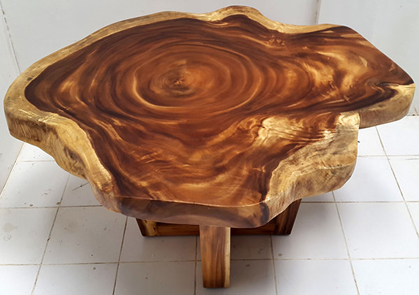 suar coffee table with natural shape and crossed legs