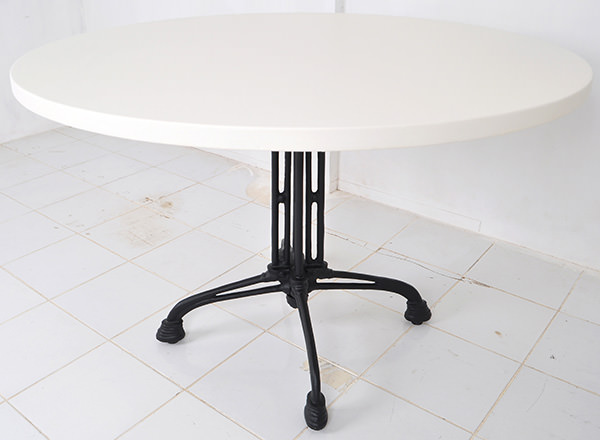 round bistro table with cast iron table legs with white table top
