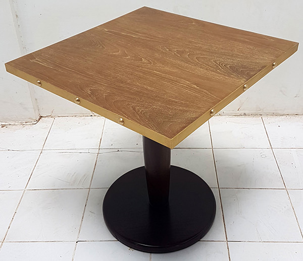 square restaurant table with brass edges