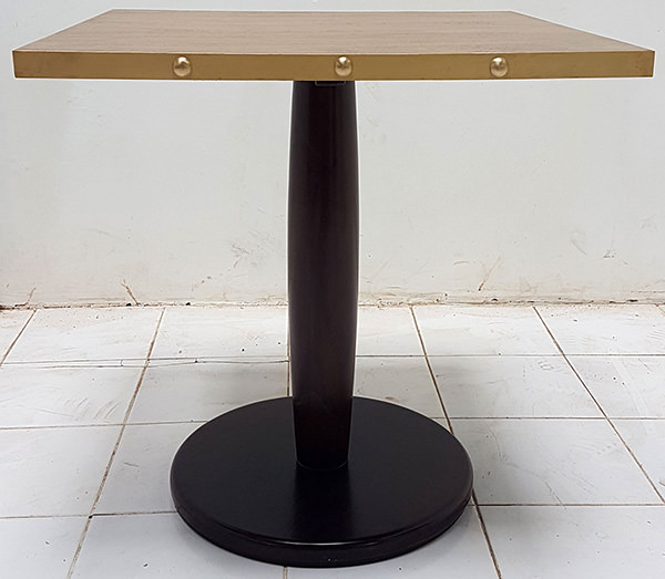 square restaurant table with brass edges and dark brown leg