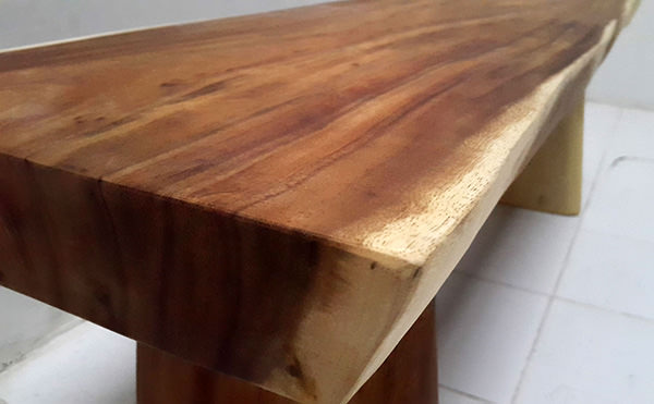 suar dining table with natural edges and clear finish