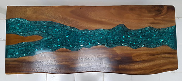 suar table with blue resin and drift wood inserts