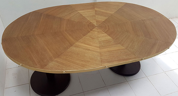oval restaurant dining table with gold washed finish