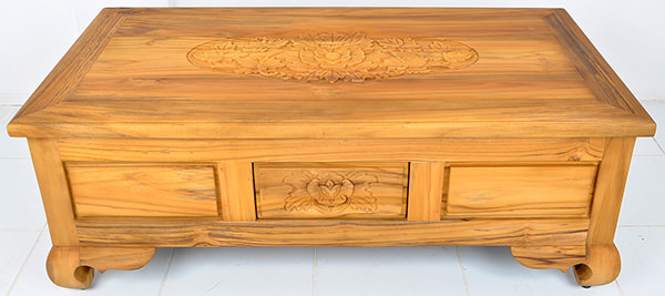 wooden coffee table with handmade carved details