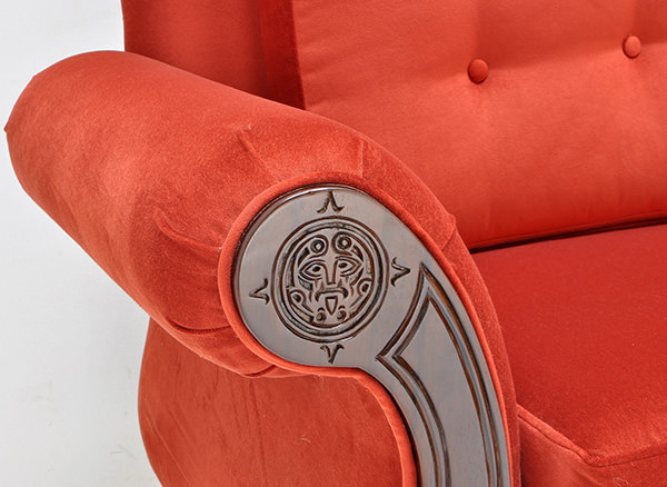 red sofa with teak wooden arms