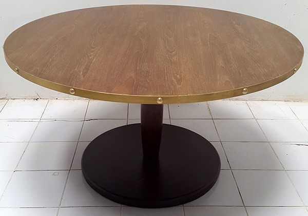 round restaurant table with brass edges and dark brown leg