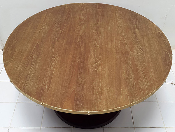 round restaurant table with brass edges and gold washed top