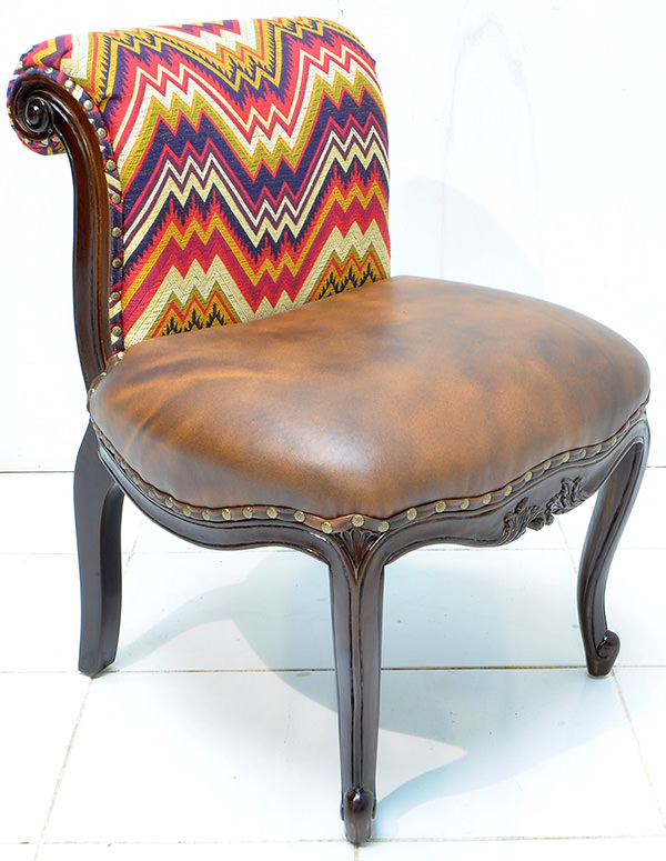 Peruvian fabric and brown leather seat