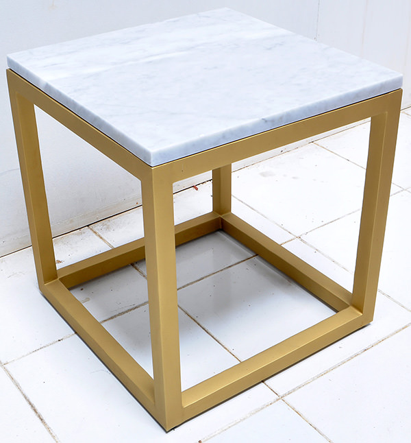 white marble and brass