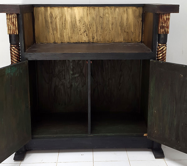 vintage restaurant reception desk with antique painting