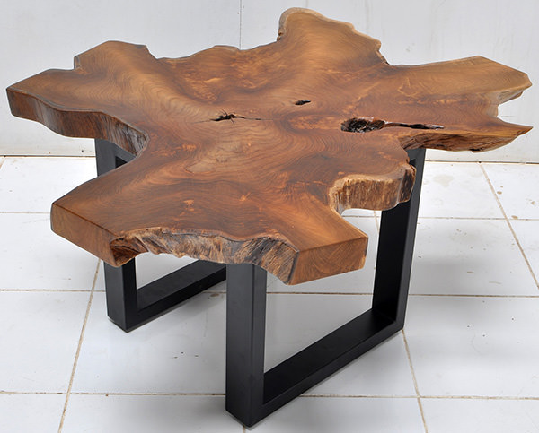 solid teak table top with a natural shape