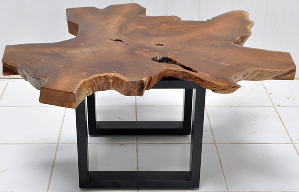 solid teak table top with a natural shape and iron legs