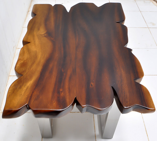 monkey pod table with a natural finish and stainless steel legs