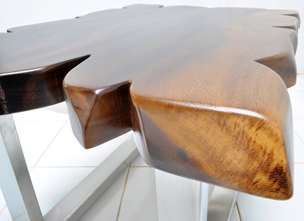 monkey pod table with a natural finish and steel legs