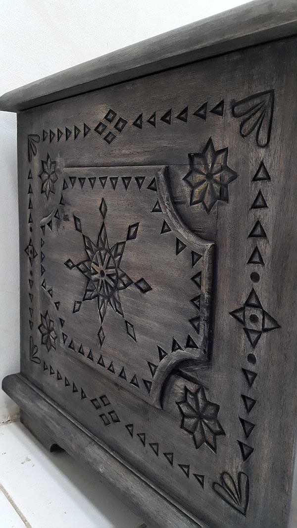 dark wood trunk with ethnic carvings