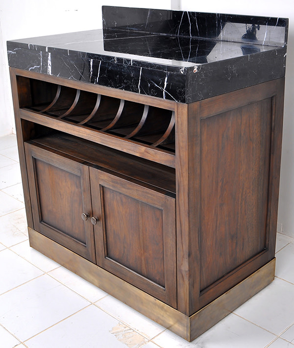 brown teak serving station with black marble top and golden brass feet