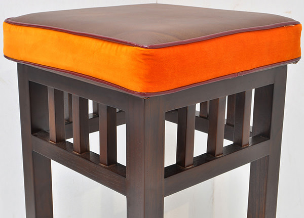 brown vintage leather and orange fabric cushion for teak bar stool