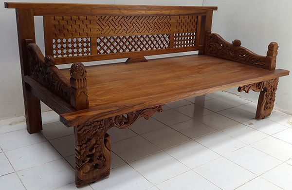 traditional asian teak bench with carvings