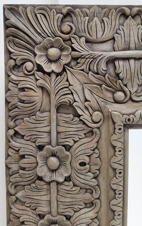 long carved mirror with flower pattern