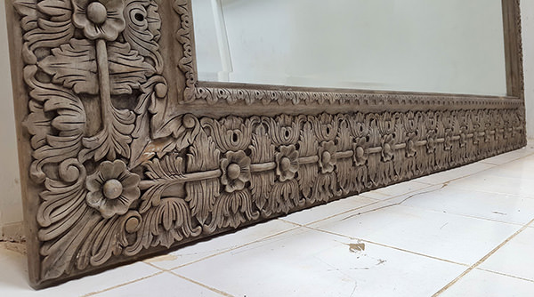 long teak mirror with black stain finish and carved pattern