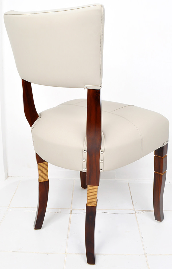 teak and white leather dining chair with brown stain and golden leg recessed