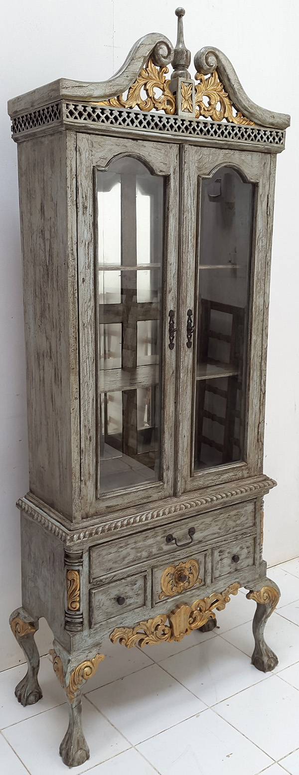 carved wooden wardrobe with a vintage finish