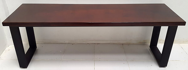 walnut color console table with black iron legs